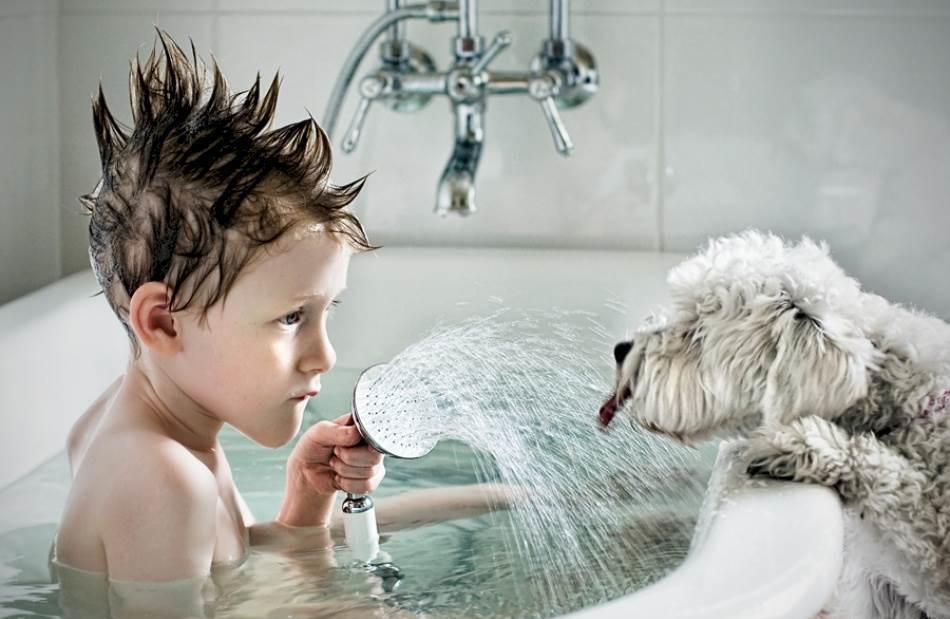 Boy and his dog taking a bath