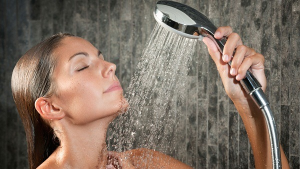 Woman with handheld shower head